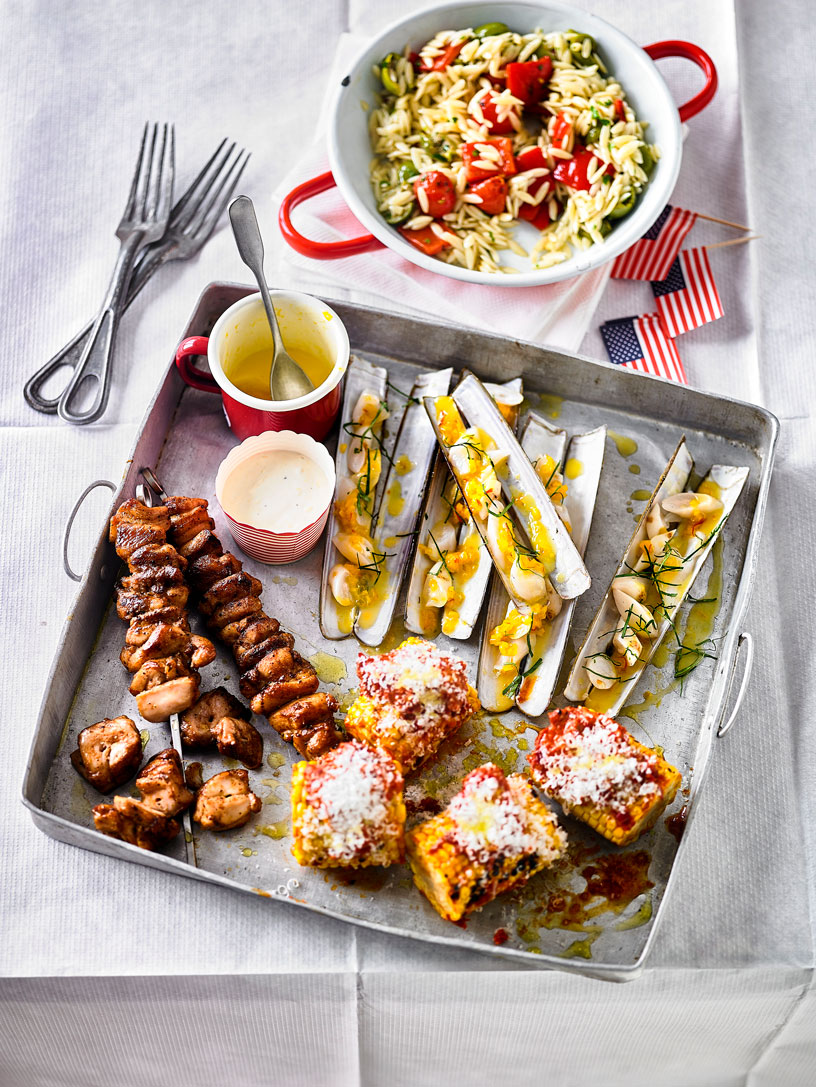 CHICKEN SKEWERS, RAZOR CLAMS AND GRILLED CORN WITH NDUJA BUTTER